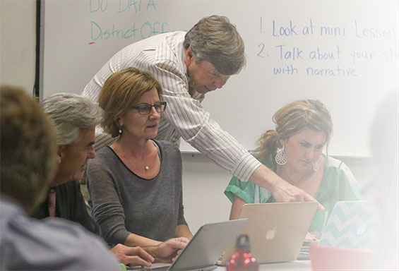 Teachers and administrators review data