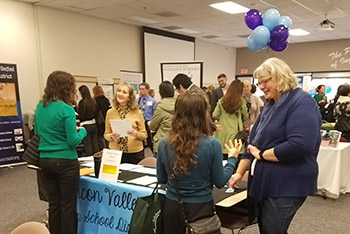 Candidates meet a school district at the job fair