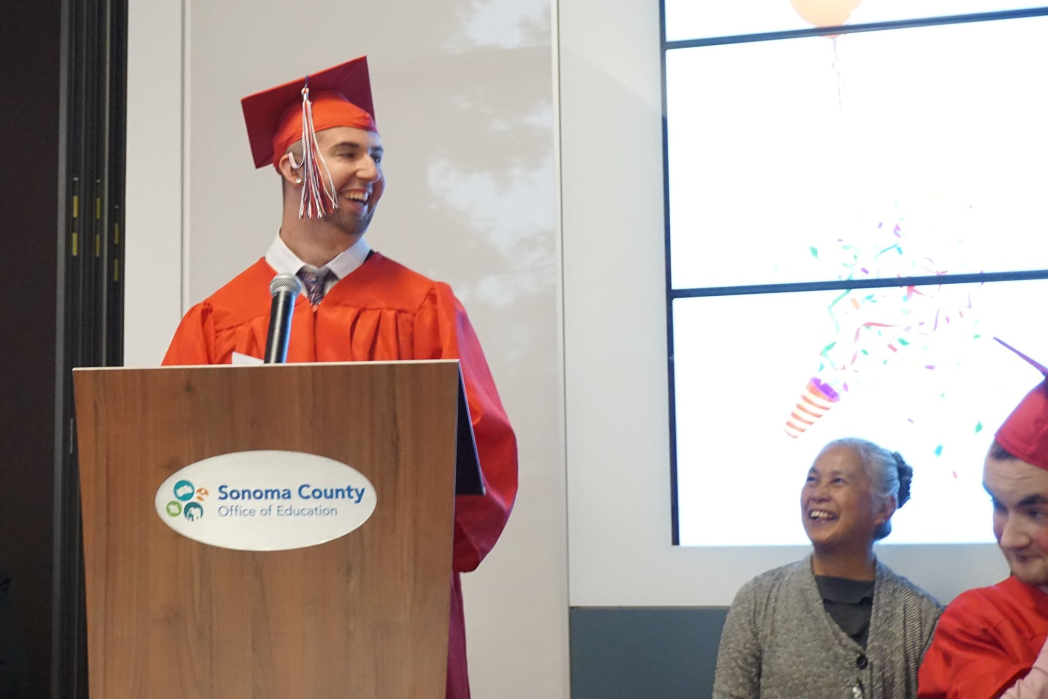 A graduate speaks at the Transition graduation ceremony.
