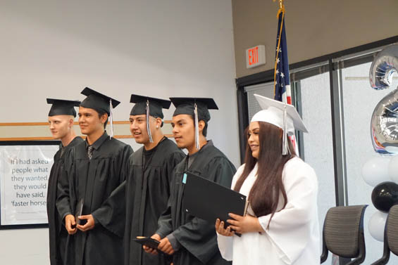 2018 Alternative Education Graduates stand with their diplomas