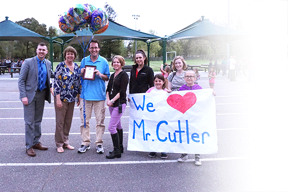 Josh Cutler receives his award at Evergreen Elementary with principal and family.
