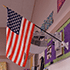 A flag was singed in the fires but still stands in a classroom as a sign of resilience
