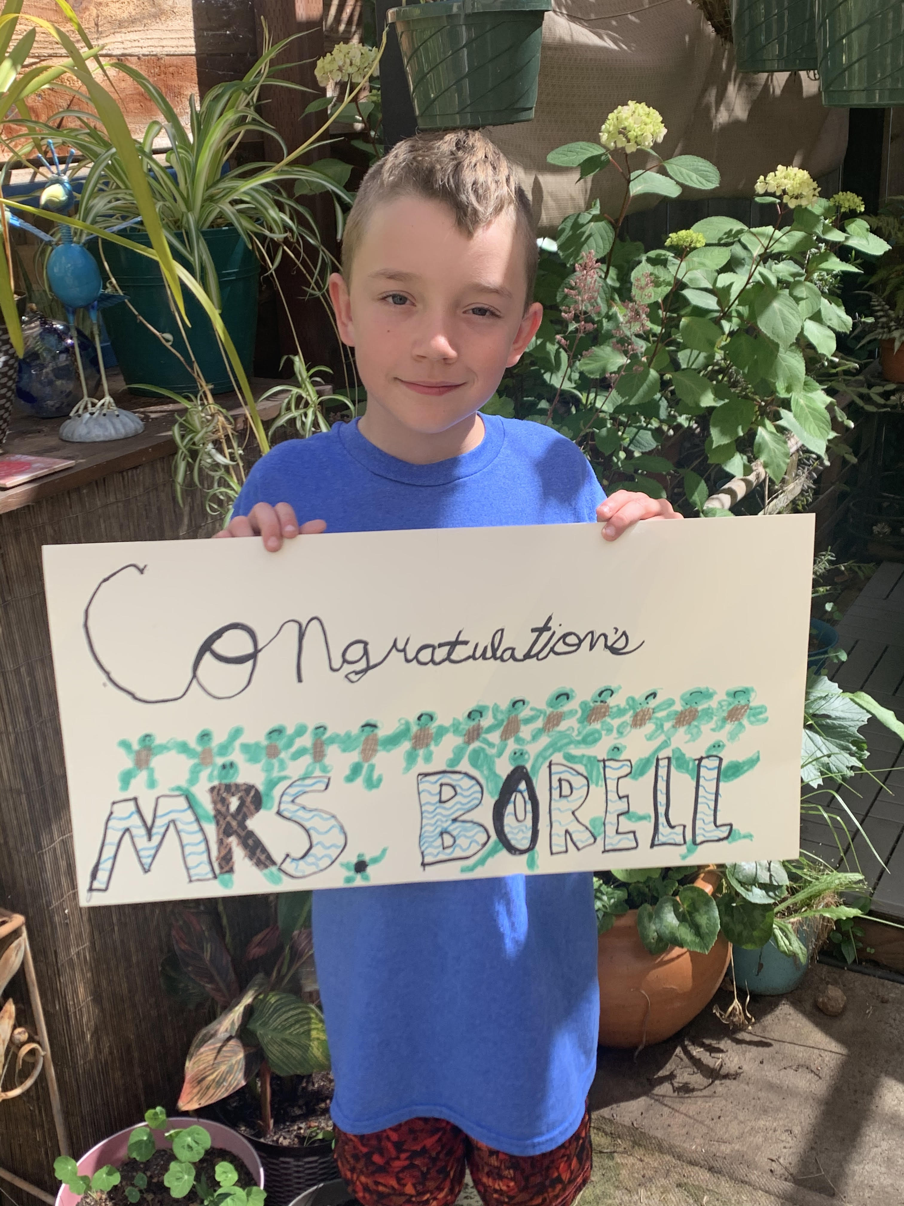 A student holds his hand-made sign for Ms. Borell