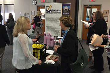 Teachers discuss jobs at job fair