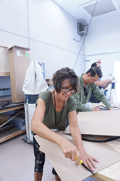 Bakersfield teacher Kathryn Bobbitt cuts a cardboard form to begin making a guitar.