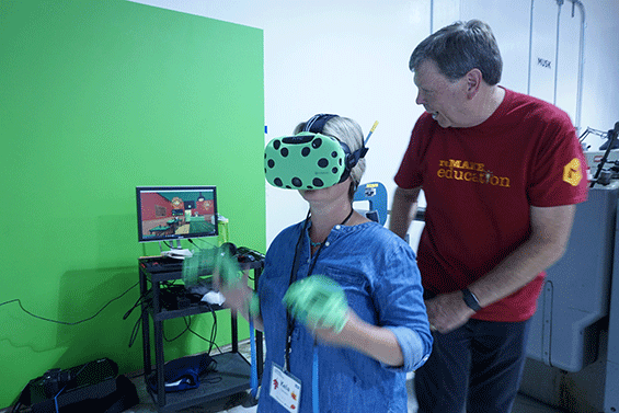 A teacher tests out virtual reality device