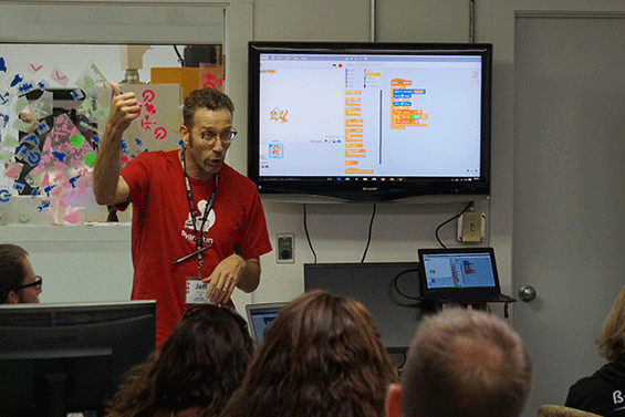 A presenter speaks to teachers at the ReMAKE conference