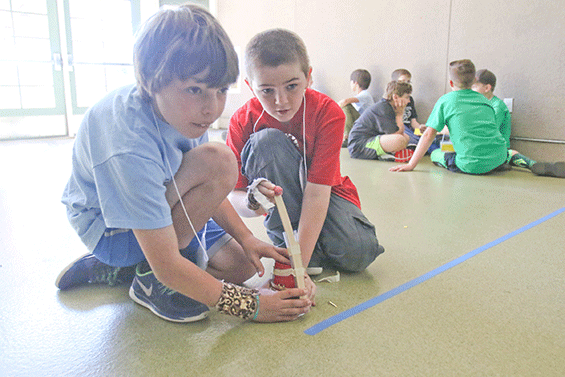 Two boys compete in Science Olympiad