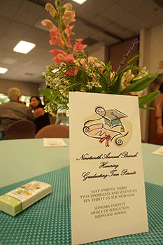 Flowers and graduation program decorate table