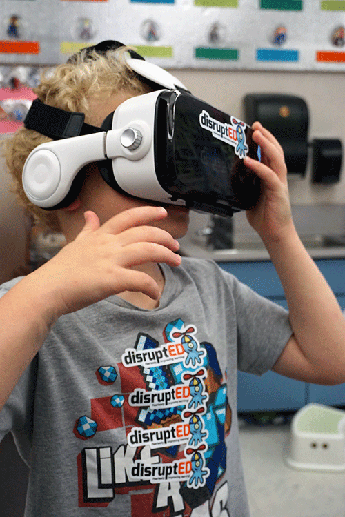 A student tries out a virtual reality headset